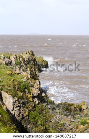 Waves crashing onto the rocks at the tip of Sand point in Somerset