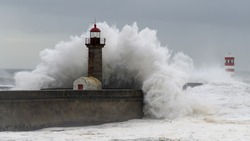 Waves crashing over a lighthouse