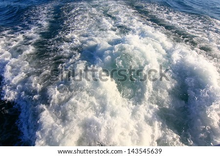 waves formed by the engine of a ship at sea