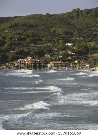 Waves from storm in the Bay of Biodola with view to Scalieri, Elba, Tuscany, Italy