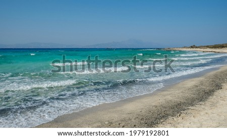 Waves going one after another on the white sand shore of the Golden beach at Chrissi island, Greece