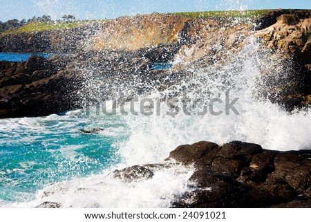Waves hitting rocky shore