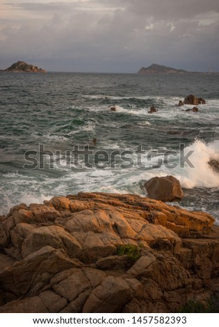 Waves in sundown in Santa Maria de Navaresse on the east side of Sardinia island, Italy #1457582393