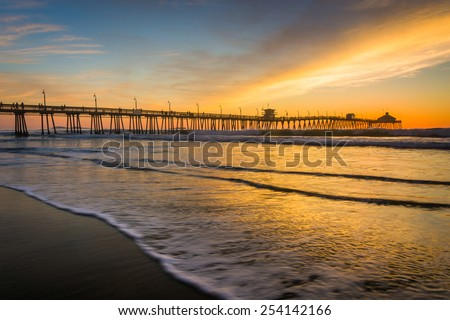 Waves in the Pacific Ocean and the fishing pier at sunset, in Imperial Beach, California.