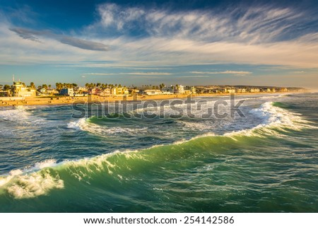 Waves in the Pacific Ocean and view of the beach from the fishing pier, in Imperial Beach, California.