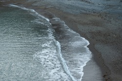 Waves movement on a shore. Flat sea, the calm of the flat sea, waves, beaches, water sports, meditation on the shore, ambient music, ebb and flow concept
