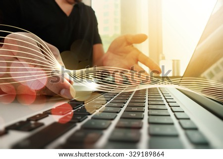 Waves of light and close up of hands using laptop and holding credit card as Online shopping concept - Shutterstock ID 329189864