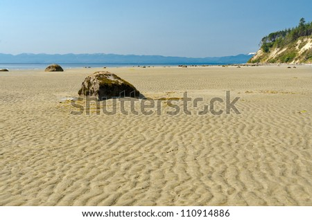 Waves of the sand on the beach in Vancouver, Canada.