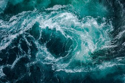 Waves of water of the river and the sea meet each other during high tide and low tide. Whirlpools of the maelstrom of Saltstraumen, Nordland, Norway
