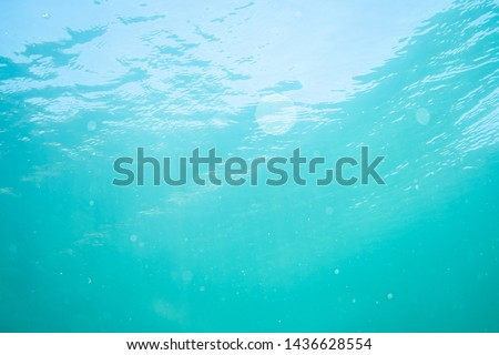 waves on a lake shot form under water, under water photography in a lake in austria #1436628554
