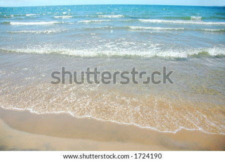 Waves on sandy beach
