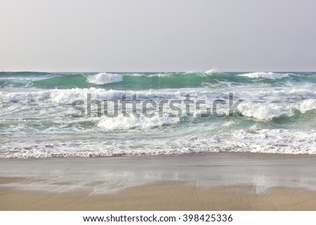 Waves on the shore #398425336