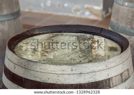 Waves on water gathered on an old and nice wood barrel