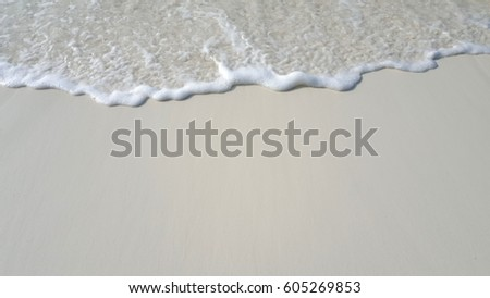 Waves on white sand background #605269853