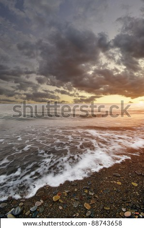 waves rolled on a rocky shore at sunset. seascape