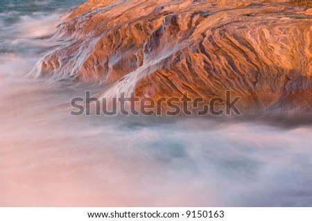 Waves splash on the eroded sandstone shore of Lake Superior, Pictured Rocks National Lakeshore, Michigan's Upper Peninsula, USA
