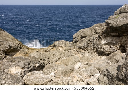 Waves splashing onto rocky seaside in Okinawa #550804552