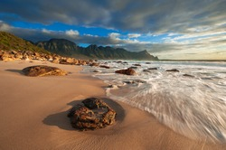 Waves wash up on the beach at Kogel Bay on the Cape Coastline.