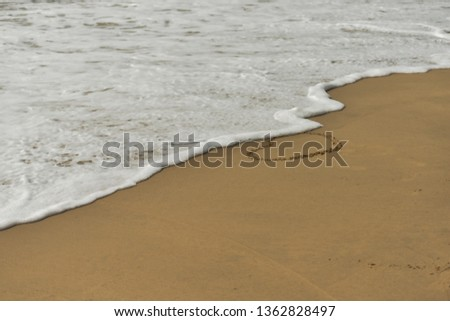 Waves wiping out love symbol on the beach. This pic taken on vizag beach, Andhra pradesh.