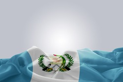 waving abstract fabric Guatemala flag on Gray background