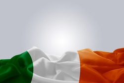 waving abstract fabric Ireland flag on Gray background