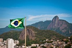 Waving Brazilian Flag with Corcovado Mountain in the Background, Rio de Janeiro, Brazil
