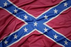 waving colorful confederate jack flag . macro shot