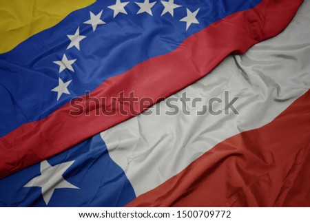 waving colorful flag of chile and national flag of venezuela. macro #1500709772