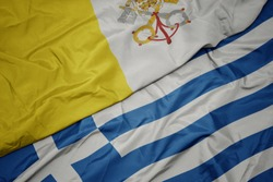 waving colorful flag of greece and national flag of vatican city. macro