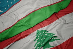 waving colorful flag of lebanon and national flag of uzbekistan. macro