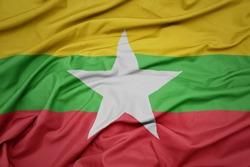 waving colorful national flag of myanmar. macro shot