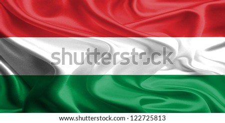 Waving Fabric Flag of Hungary - stock photo