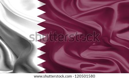 Waving Fabric Flag of Qatar - stock photo