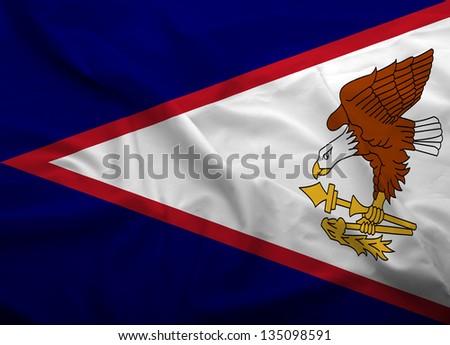 Waving flag of American Samoa. Flag has real fabric texture.