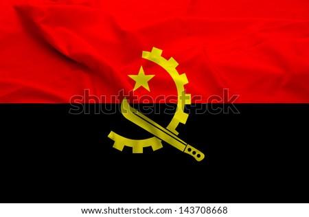 Waving flag of Angola. Flag has real fabric texture.
