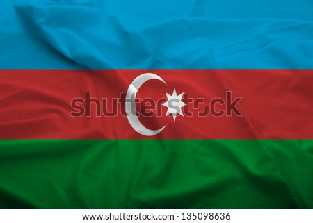 Waving flag of Azerbaijan. Flag has real fabric texture.