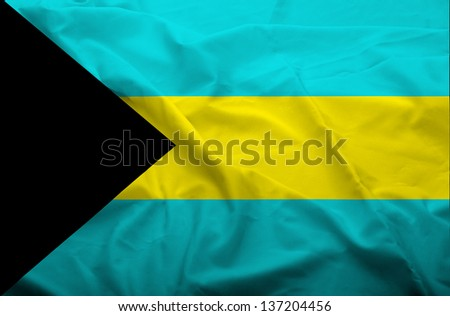 Waving flag of Bahama. Flag has real fabric texture. - stock photo