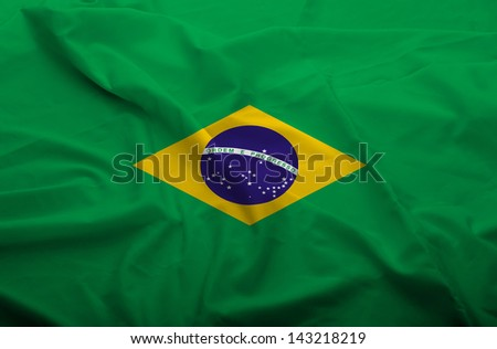 Waving flag of Brasil. Flag has real fabric texture.
