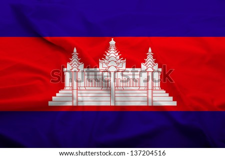Waving flag of Cambodia. Flag has real fabric texture. - stock photo
