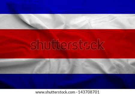 Waving flag of Costa rica. Flag has real fabric texture.