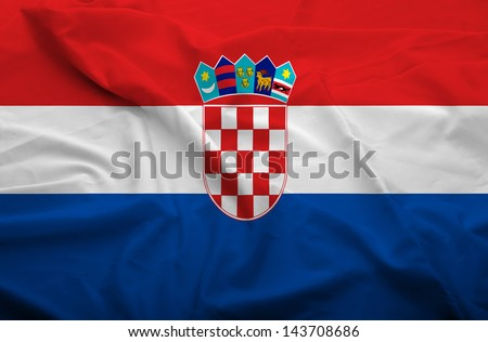 Waving flag of Croatia. Flag has real fabric texture.