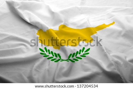 Waving flag of Cyprus. Flag has real fabric texture.