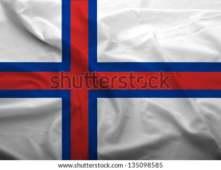 Waving flag of Faroe Island. Flag has real fabric texture.