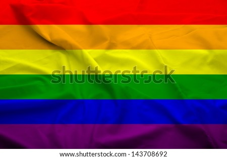 Waving flag of gay population. Flag has real fabric texture.