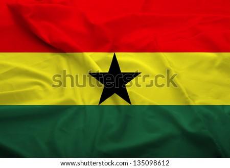 Waving flag of Ghana. Flag has real fabric texture.
