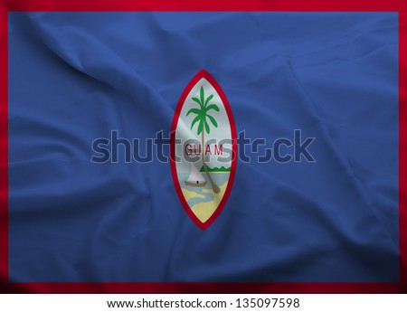 Waving flag of Guam. Flag has real fabric texture.