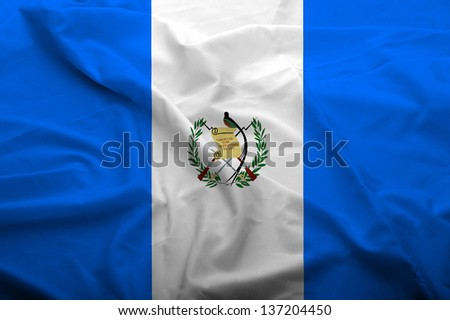 Waving flag of Guatemala. Flag has real fabric texture.