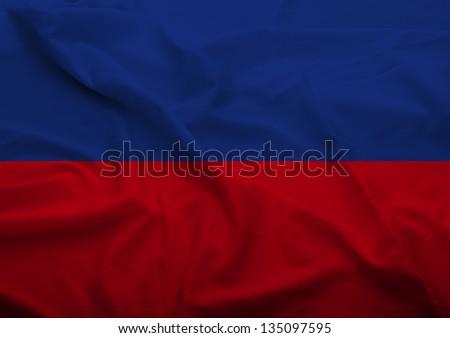 Waving flag of Haiti. Flag has real fabric texture.