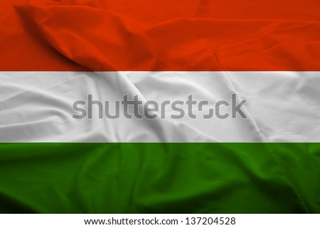 Waving flag of Hungary. Flag has real fabric texture.