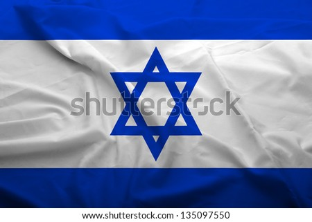 Waving flag of Israel. Flag has real fabric texture.